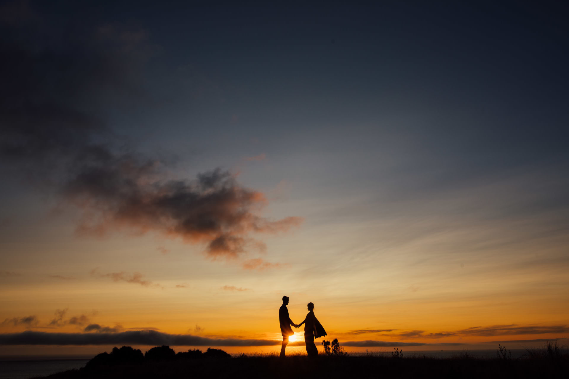 Wedding silhouette sunset photo with bride and groom