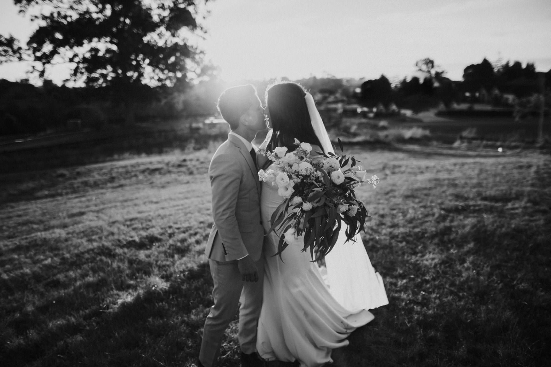 Black and white sunset wedding photograph