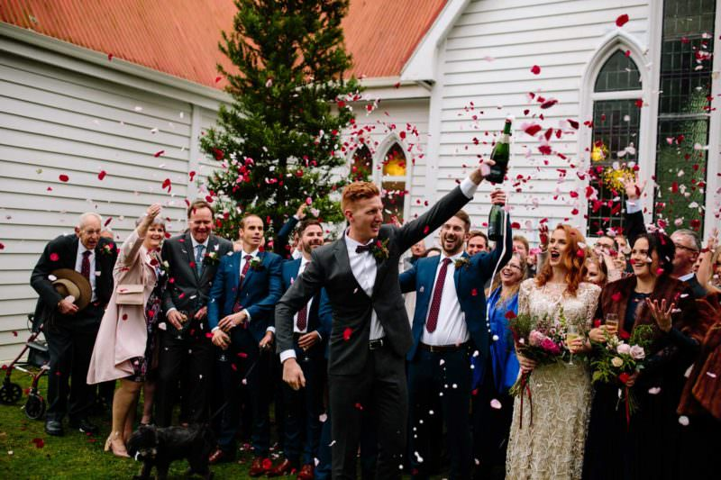 pukekohe wedding photography photo of groom popping champagne