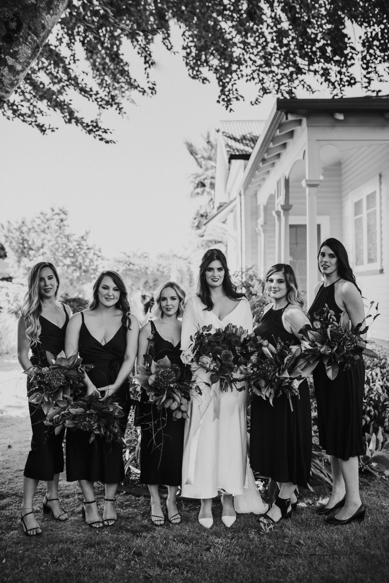 Bride and Bridesmaids in black dresses