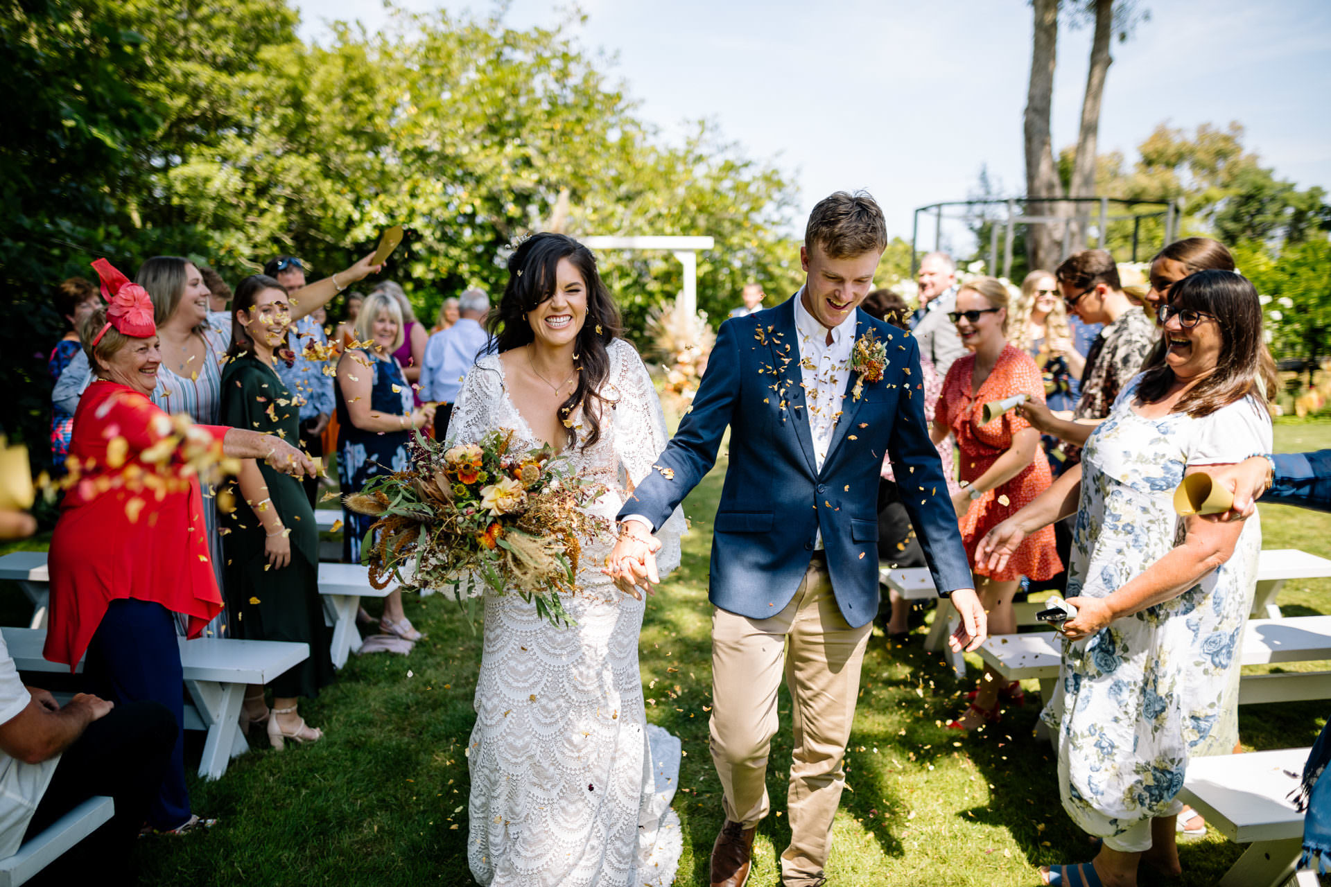 Bride and groom confetti isle photograph