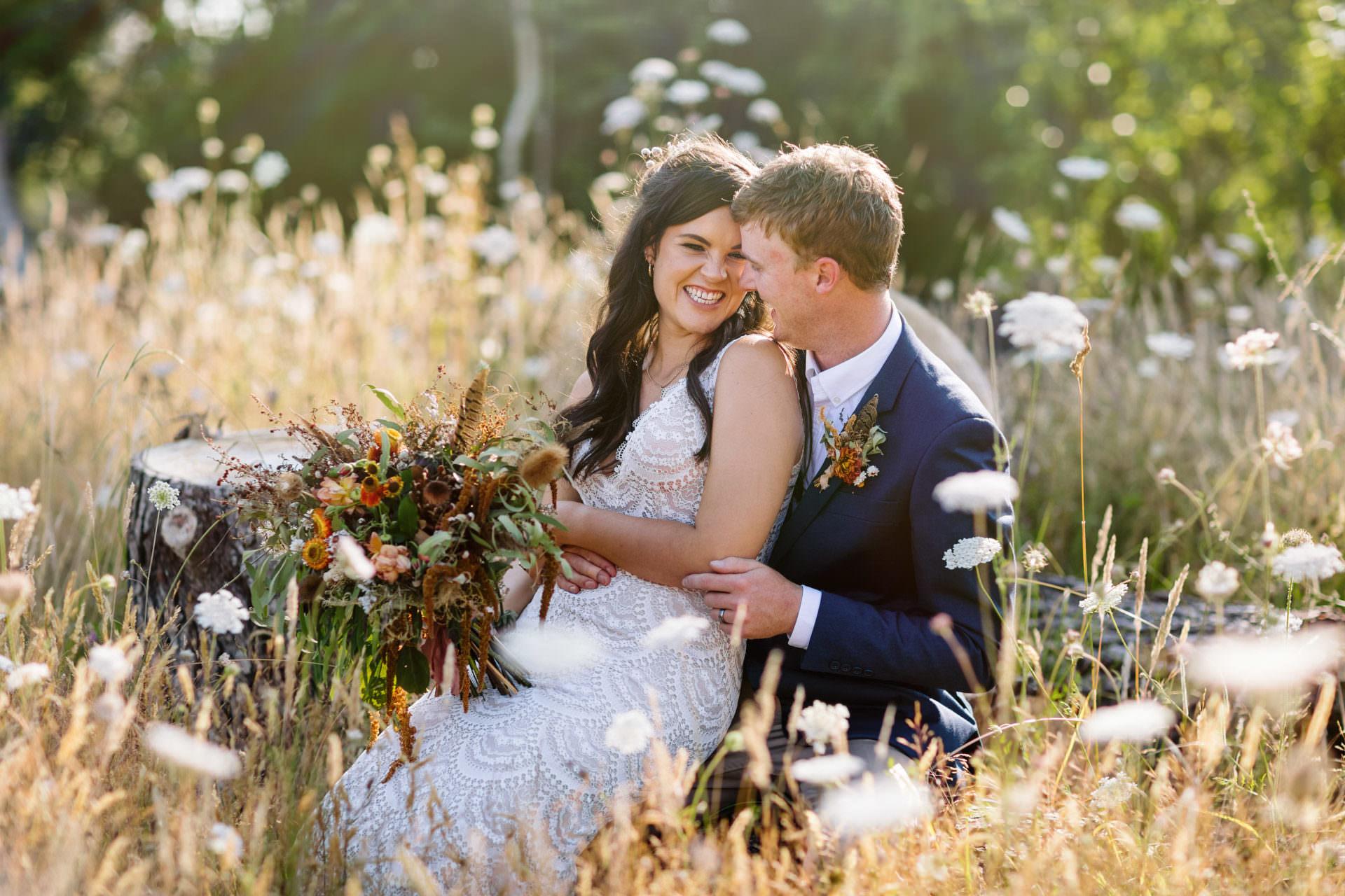 bride and groom flower field wedding photograph