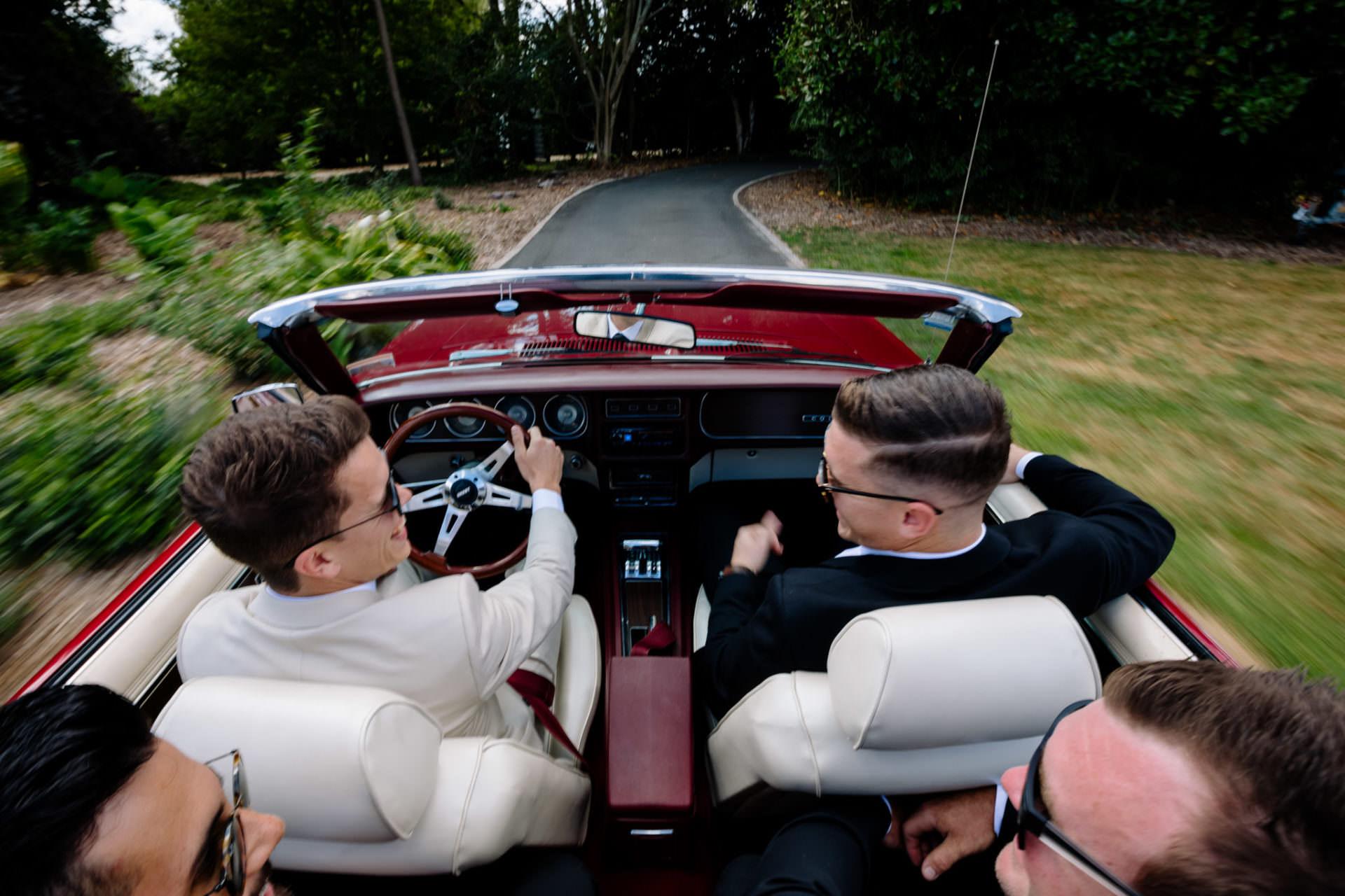 Bridal car with groomsman